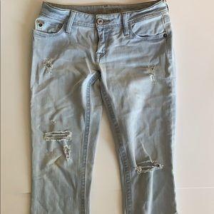 DL1961 distressed light wash skinny jeans